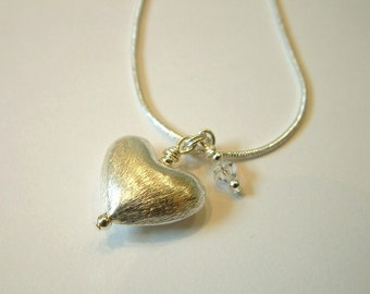 Sterling silver puffed heart and Swarovski crystal charm necklace