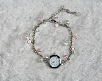 Shows pink and white glass beads