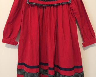 1990s Vintage Red cotton long sleeved girls dress with polka dot trim. Size 5/6.