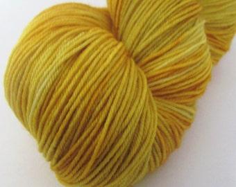 "Hand dyed sock yarn in ""Wheat Field"" colorway"