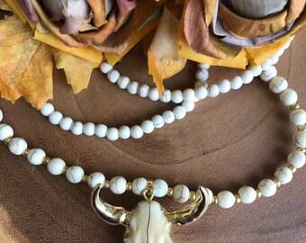 Gold beige onyx bull skull pendant on neutral hand beaded necklace
