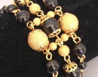 Black and Gold Pearl Bracelet; Multi-Strand Beaded Bracelet; Black and Gold Bracelet; Statement Bracelet; Black and Gold Link Bracelet