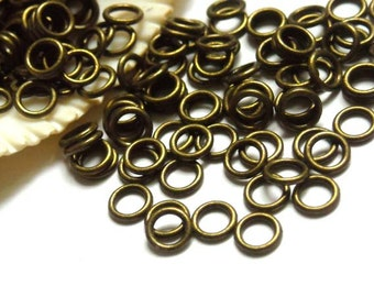50/100 Antique Bronze Jump Rings 6mm, Closed Loop - 11-6