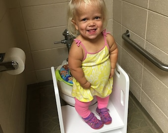 Get up and GO Potty Helper Two-Step Stool. Has  4 handles for ease of use. Sturdy and solid, glued and screwed. Fits your toilet!  - WHITE