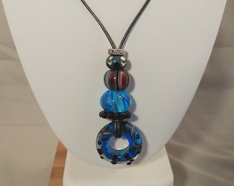 Aqua blue, coral and black Artisan Glass Bead Necklace on leather cord