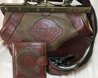 Rate Vintage leather Gerpa satchel with matching wallet.