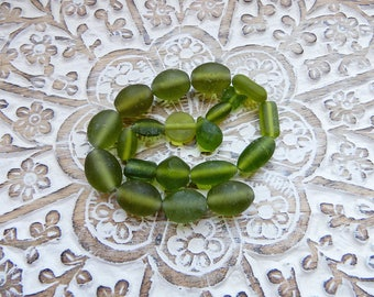 Assorted green glass beads