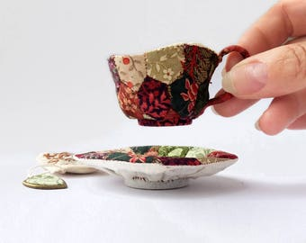 "Miniature Soft Sculpture, ""Know Your Own Strength"" Patchwork Teacup and Saucer"