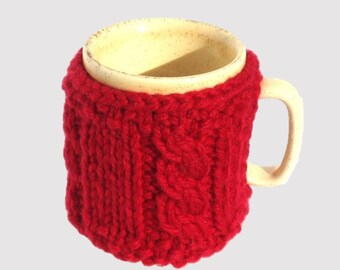 Mug cosy / cup cover hand-knitted in bright red pure wool. Mug cozy