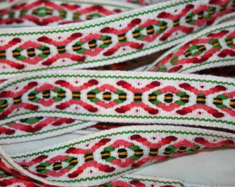 "Over 5 yards of cotton 1"" wide woven trim in pink reds green black and yellow, X and O pattern"