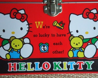 1990 Sanrio Hello Kitty Bento Tin Box. Made in Japan. Featuring Kitty, Mimmy, and their Teddy Bears. Used Vintage.