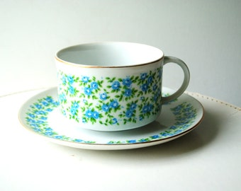 Chubby cottage chic vintage 70s white porcelain large cup and saucer with a hand painted forget me not design.