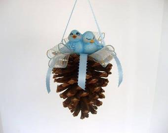 Ornament, pine cone ornament, decorated pine cone with ceramic bluebirds