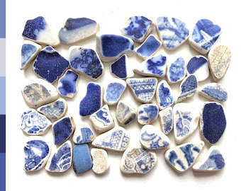 Sea pottery pieces, small blue and white beach pottery shards, washed up on the Edinburgh beach 0042