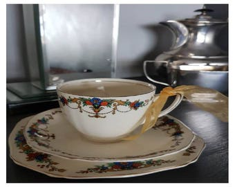 Alfred Meakin Trio, Tea cup, Saucer and Tea Plate with unsented white parafin wax candle