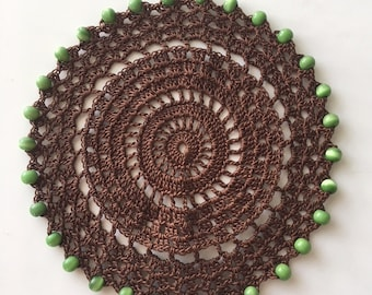 """Brown 6.5"""" doily with green  beads"""
