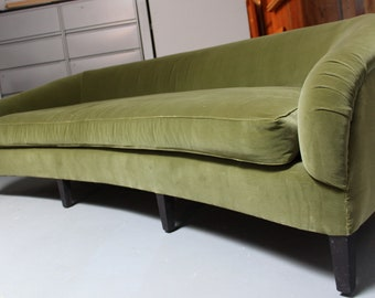 Arched back sofa with wood base