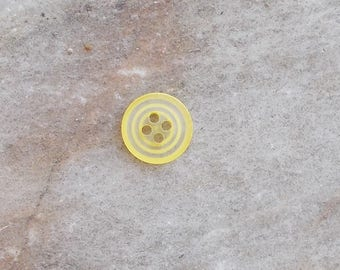 Spiral clear button 4 hole 11mm yellow