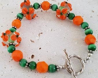 Orange Floral Bracelet, Orange Bracelet, Green Bracelet, Beaded Bracelet