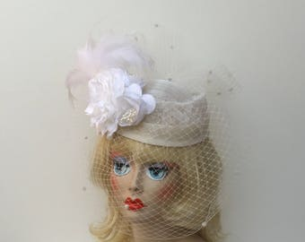 SALE  White pillbox with flower and white veiling.