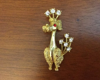 Gold tone and rhinestone poodle brooch