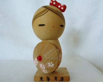 1064: Kokeshi doll, Vintage Japanese wooden  Kokeshi doll on stand, signed,Handcrafted in Japan