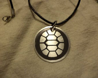 TMNT inspired 2 sided nickel silver pendant