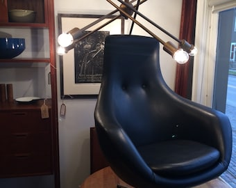 Overman chair in black vinyl with swivel fishtail pod chair Klote