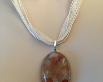 oval pendant quartz and carnelian gemstone chips in resin with copper coil beige ribbon necklace