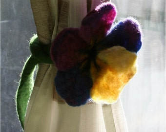 A needle felted flower - can be used as a curtain tie back, wrist or neck ornament