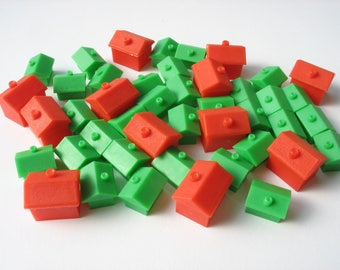 40 vintage Monopoly game pieces, 28 plastic houses and 12 hotels