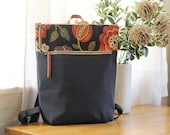 Dark navy blossom canvas Backpack, laptop backpack , diaper backpack, diaper bag. 7 inside pockets, Waterproof poly lining available
