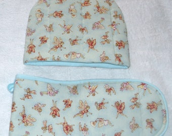 Dancing Flower Fairies on pale blue tea cosy and  oven gloves