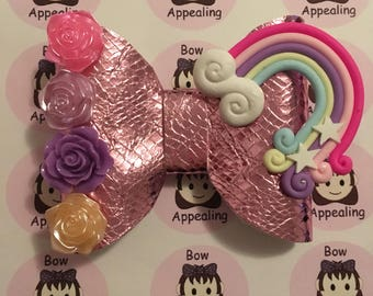 Pink metallic hair bow with rainbow and flowers for girls  for parties or dress up