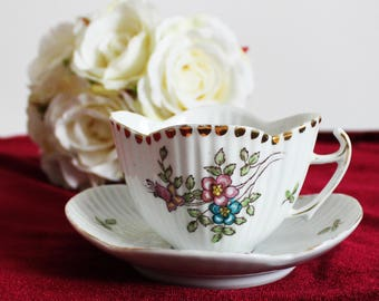 Antique small coffee cup demitasse Vintage teacup cup and saucer England White pink blue flowers unusual shape teacup English bone china