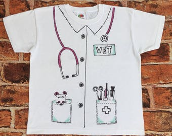 Childrens' bespoke, hand-drawn fancy dress/dress-up tee shirt. 'Vet' style in various colours on white. Can be further customised.