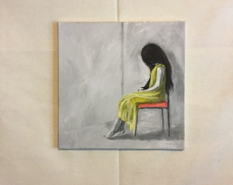 Girl on red chair with yellow dress
