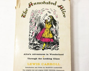 The Annotated Alice. Alice's Adventures in Wonderland & Through the Looking Glass. Vintage paperback book circa 1960. Lewis Carroll.
