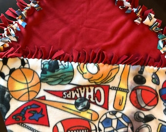 "Sports themed Fleece blanket 50"" x 64""  for you washable and reversible"