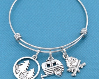 Camping bangle bracelet in stainless steel with silver toned mountain range, camper and camp fire metal charms.