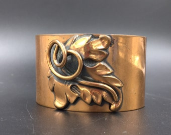 Copper cuff bracelet with floral detail