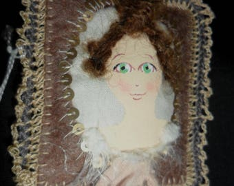 Textile embroidery and crochet cameo brooch