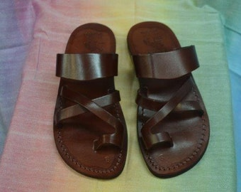 Leather   Jesus toe sandals for men , can serve for women too come in brown and black color  , made in Jerusalem .