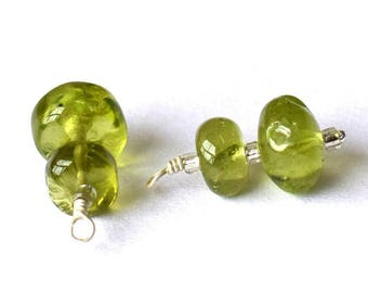 Very pretty pair of smooth Peridot rondelles on silver wire