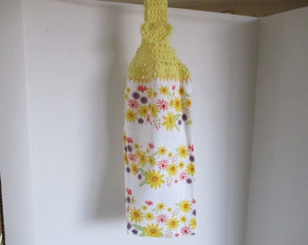 Floral kitchen towel, yellows, oranges, purple, crocheted hanger, yellow yarn, kitchen towel, patio, hand towel, hand drying, kitchen linens