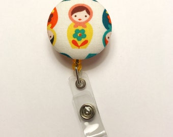 Badge reel, yellow nesting doll fabric button badge reel