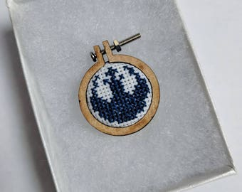 Star Wars Resistance inspired cross stitch necklace