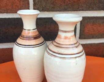 A pair of tiny vases