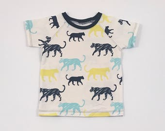 Puma Shirt. Boy Tee Shirt. Organic Cotton Shirt. Jersey Knit Tee. Stripe Patch Pocket. Boy Tee. Short Raglan Sleeve. Animal Print.