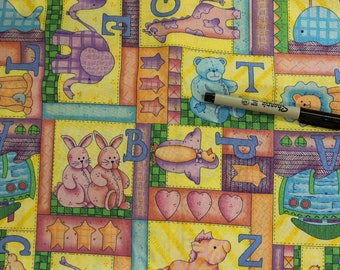 ABC's and stuffed animals patchwork on yellow  100% cotton fabric by Leslie Beck for VIP